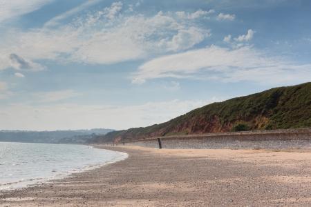 warren: Red rock beach near Dawlish Warren Devon Stock Photo