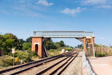 warren: Bridge over railway track Dawlish Warren Devon