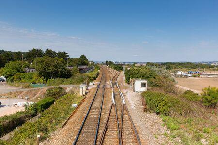 warren: Railway tracks Dawlish Warren Devon England on blue sky summer day
