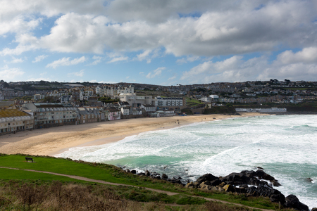known: Porthmeor beach St Ives Cornwall England with white waves breaking towards the shore and known for surfing Stock Photo