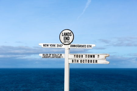 Signpost at Land s End Cornwall UK the most westerly point of England on the Penwith peninsula eight miles from Penzance on the Cornish coast Stock Photo