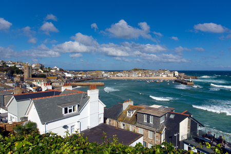 View of St Ives Cornwall England with harbour, boats and blue sea and sky, a traditional Cornish fishing town in the UK Stock Photo
