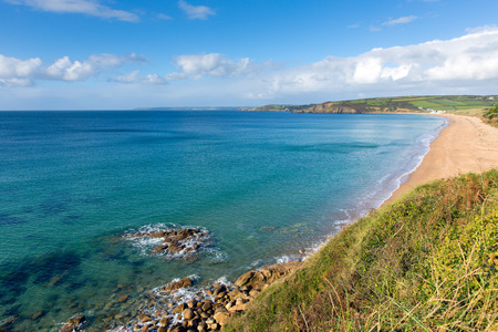 mousehole: Praa Sands Cornwall England view west towards Penzance and Mousehole on the South West Coast Path with a sandy beach and blue sky on a beautiful sunny day