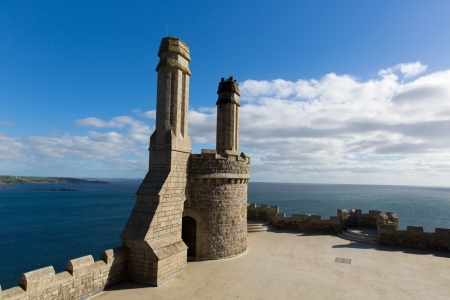 Top of St Michael s Mount medieval castle Cornwall England with blue sky and cloud
