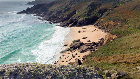 porthcurno: English beach in autumn at Porthchapel Cornwall England near the Minack Theatre and Porthcurno Stock Photo