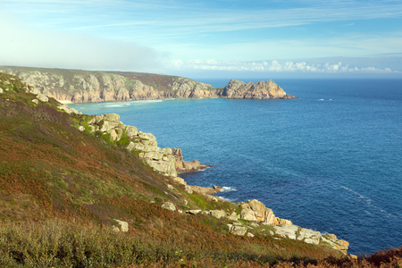 porthcurno: Coast of Cornwall England in autumn blue sky near the Minack Theatre and Porthcurno