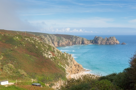 porthcurno: Coast of Cornwall England in autumn with mist and blue sky near the Minack Theatre and Porthcurno Stock Photo