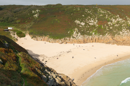 porthcurno: Autumn colours at Porthcurno beach Cornwall England UK by the Minack Theatre