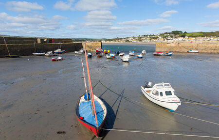 Boats in St Michaels Mount Harbour Cornwall England at low tide