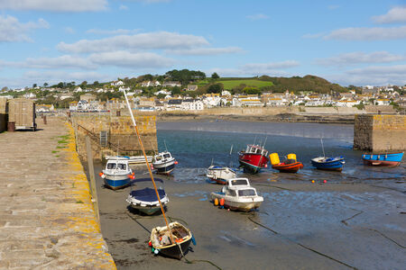 Boats in St Michaels Mount Harbour Cornwall England at low tide photo