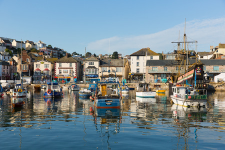 Brixham harbour Devon England with boats on a calm day with blue sky during the heatwave of Summer 2013