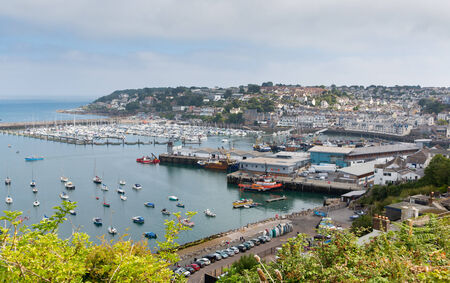 Brixham harbour and marina Devon England with boats on a calm day with blue sky during the heatwave of Summer 2013