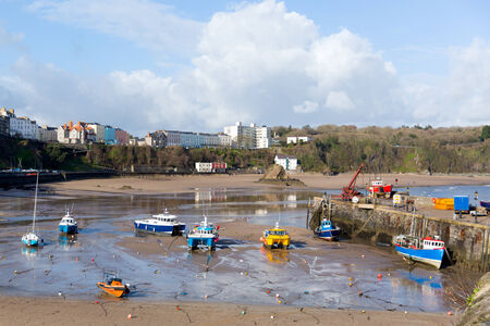 tenby wales: Boats in Welsh harbour of Tenby Pembrokeshire Wales historic Welsh town on west side of Carmarthen Bay with great beaches and history