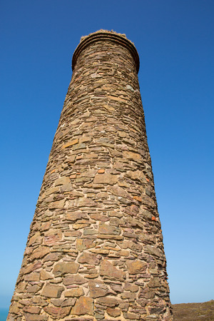 tall chimney: Tall industrial chimney and blue sky Stock Photo