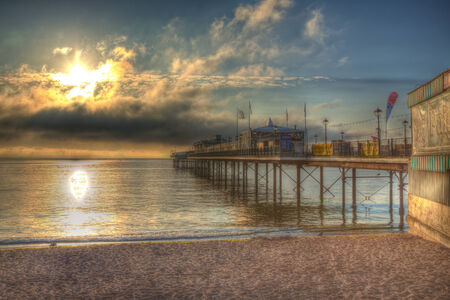 kingdom of heaven: Paignton Pier with dramatic sky and moody clouds and sunlight in HDR