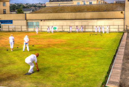 leisurely: Leisurely sport of bowls on a bowling green in England in HDR Editorial
