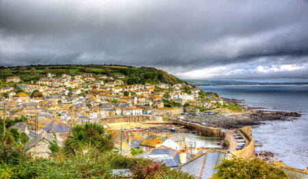 mousehole: View of Mousehole harbour and fishing village Cornwall England UK