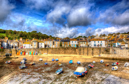 mousehole: Blue sky clouds and boats Cornwall harbour of Mousehole Stock Photo