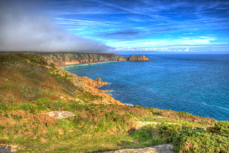 Cornwall coast in autumn mist at Minack