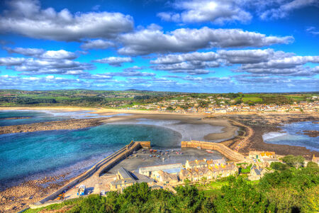 Top of St Michaels Mount medieval castle Cornwall England with blue sky and cloud in HDR photo