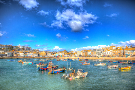 St Ives harbour Cornwall England with boats in the harbour and blue sea and sky in this traditional Cornish fishing town in the UK in HDR