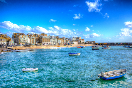 St Ives Cornwall England with boats in the harbour and blue sea and sky in this traditional Cornish fishing town in the UK in HDR