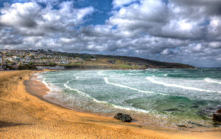 English surfing beach at Porthmeor St Ives Cornwall England with blue sky and clouds in HDR photo
