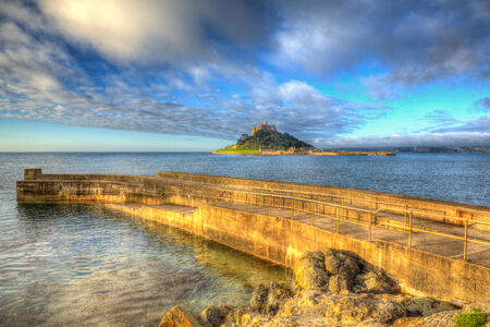 mount saint michael: Jetty and St Michaels Mount Marazion Cornwall England UK medieval castle and church from the island in colourful HDR