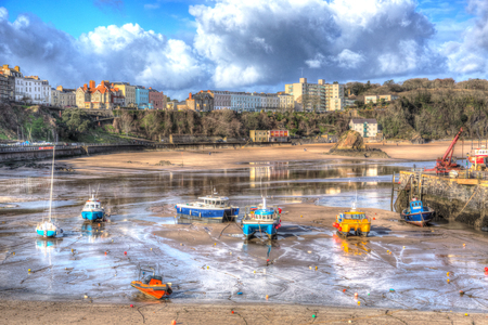 tenby wales: Boats in Welsh harbour of Tenby Pembrokeshire Wales historic Welsh town on west side of Carmarthen Bay with great beaches and history in HDR Editorial