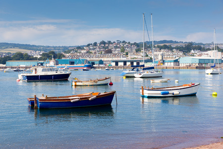 Boats on Teign river Teignmouth Devon tourist town with blue sky a colourful traditional English coastal scene