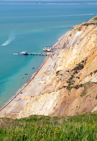 iow: Isle of Wight beach at Alum Bay next to the Needles tourist attraction Stock Photo