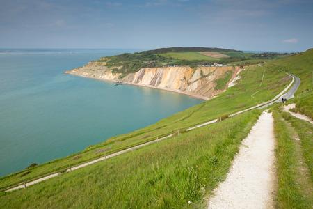 Coast path Alum Bay Isle of Wight beautiful beach and rocks next to the Needles tourist attraction