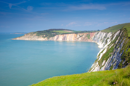 iow: isle of Wight coast Alum Bay beautiful beach and rocks next to the Needles tourist attraction Stock Photo