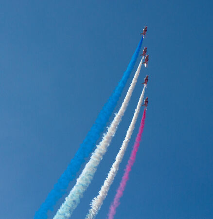 brean down: The Red Arrows jet planes with blue sky and colourful smoke Editorial