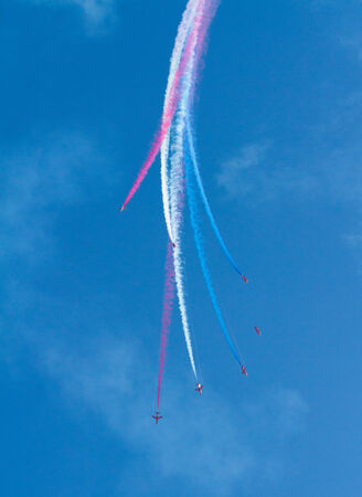 brean: RAF Royal Airforce Air Force aerobatic team The Red Arrows with smoke trails red white and blue