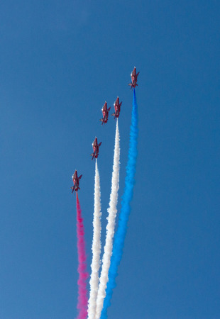 brean down: RAF Royal Airforce Air Force aerobatic team The Red Arrows with smoke trails red white and blue