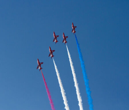 brean down: The Red Arrows with smoke trails red white and blue Editorial