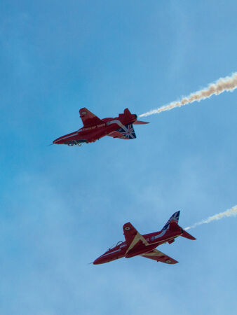 brean down: RAF Royal Airforce Air Force aerobatic team The Red Arrows with smoke trails
