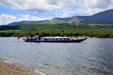 lake district england: Gondola steam boat on Coniston water Lake District England uk on a beautiful sunny summer day in this popular tourist attraction