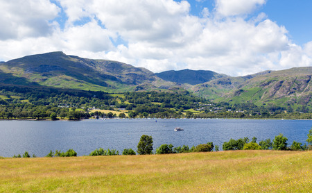 lake district england: Coniston Water and mountains Lake District England uk blue sky