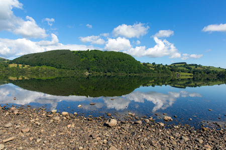 Ullswater, The Lakes in Cumbria, England with mountains and blue sky and clouds on beautiful calm summer day with reflections from sunny weather photo