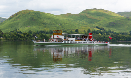 Ullswater Steam ferry with tourists at Lake District in Cumbria, England
