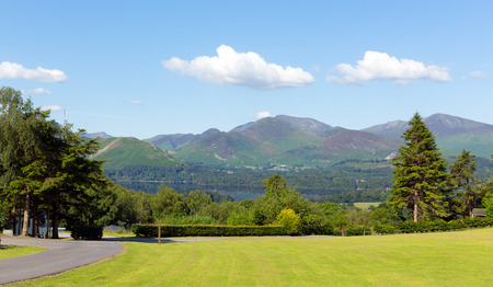 fells: View from Castlerigg Hall Keswick Lake District Cumbria to Derwent Water and Catbells mountains and fells on a summer day with blue sky and sunshine