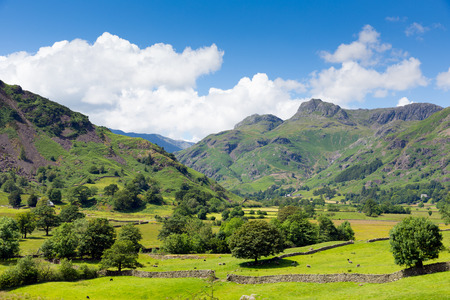 Langdale Valley Lake District Cumbria with mountains blue sky and clouds on beautiful summer day