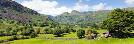 langdale pikes: Langdale Valley Lake District Cumbria with mountains blue sky and clouds on beautiful summer day panorama