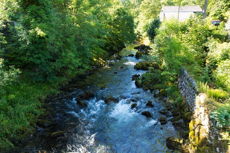 langdale: Elterwater river Lake District Cumbria valley of Great Langdale in summer sun Stock Photo
