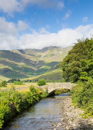 langdale pikes: Beautiful Lake District river Mickleden Beck Langdale Valley by Old Dungeon Ghyll Cumbria England United Kingdom UK by campsite Stock Photo