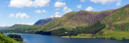 fells: Panorama Buttermere English Lake District Cumbria England uk surrounded by fells including High Stile, Robinson, Fleetwith Pike, Haystacks, and Grasmoor Stock Photo