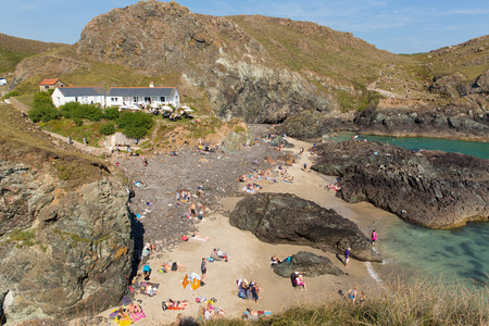 south west england: Tourists and holidaymakers enjoying late summer sunshine at Kynance Cove beach Lizard Heritage coast South West England uk
