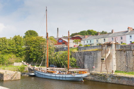 Tall ship Charlestown harbour near St Austell Cornwall England UK in summer with blue sky and sea with tourists